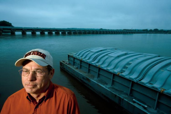 Warsaw, Illinois, farmer and chairman of the local drainage district, Sam Zumwalt, age 64, near a Mississippi River barge getting loaded with corn at the Ursa Farmers Co-op, in Meyers, Illinois. He has long been a champion of better flood control for the 16,000 acres of lowlands that make up the district. Water from the nearby Mississippi River reached 25-feet above flood stage in both 1993 and 2008 flooding 30,000 acres of nearby fertile lowlands.