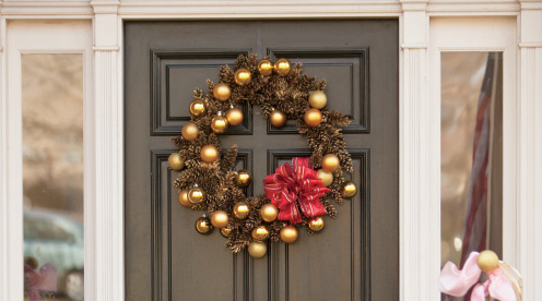 A pinecone wreath made on a wreath ring and spraypainted gold.