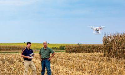 drone and farmers in Illinois cornfield